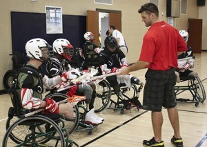A group of wheelchair lacrosse players.